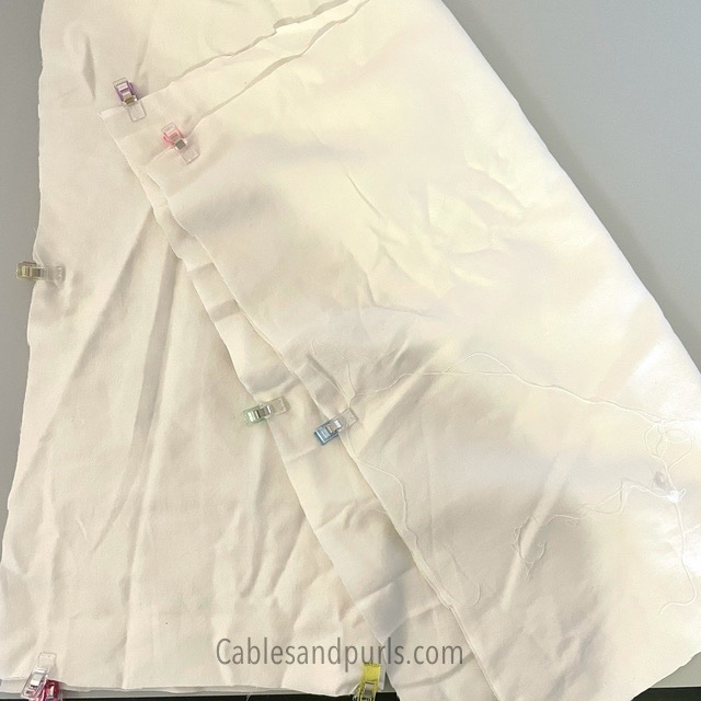White sheet cut out for  making pillow cases